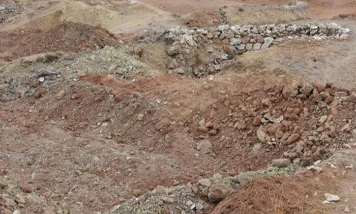 Komşuda 500 kişilik toplu mezar bulundu